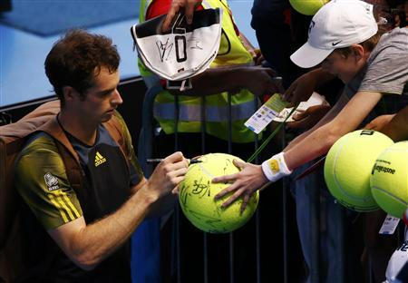 Andy Murray of Britain signs autographs for fans after defeating Gilles Simon of France in their men's singles match at the Australian Open tennis tournament in Melbourne January 21, 2013. REUTERS/David Gray