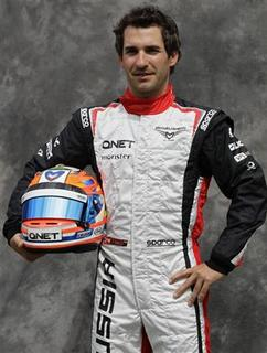 Marussia Formula One driver Timo Glock of Germany poses prior to the Australian F1 Grand Prix at the Albert Park circuit in Melbourne March 15, 2012. REUTERS/Mark Horsburgh