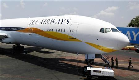 A newly acquired Jet Airways Boeing 777-300ER aircraft sits on the tarmac at Mumbai airport May 13, 2007. REUTERS/Punit Paranjpe/Files