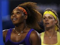 Serena Williams of the U.S. and Maria Kirilenko of Russia (R) shake hands with the chair umpire after their women's singles match at the Australian Open tennis tournament in Melbourne January 21, 2013. REUTERS/Damir Sagolj