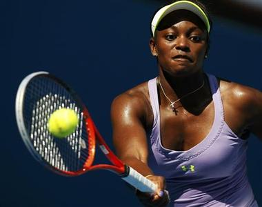 Sloane Stephens of the U.S. hits a return to Bojana Jovanovski of Serbia during their women's singles match at the Australian Open tennis tournament in Melbourne January 21, 2013. REUTERS/Damir Sagolj