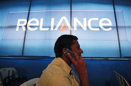 A shareholder speaks on a mobile phone while attending the annual general meeting of Reliance Capital in Mumbai September 27, 2011. REUTERS/Danish Siddiqui/Files