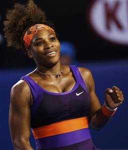 Serena Williams of the U.S. celebrates defeating Maria Kirilenko of Russia in their women's singles match at the Australian Open tennis tournament in Melbourne January 21, 2013. REUTERS/Damir Sagolj