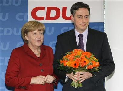 German Chancellor Angela Merkel and Lower Saxony federal state premier David McAllister are seen before a board meeting of Merkel's Christian Democratic Union party CDU in Berlin January 21, 2013. REUTERS/Wolfgang Rattay