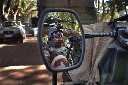 A French soldier is reflected in the mirror of a military jeep in Niono January 20, 2013. REUTERS/Joe Penney