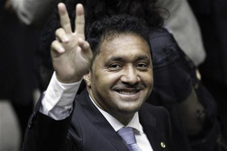 Francisco Everardo Oliveira Silva, better known by his clown name Tiririca, gestures during the inauguration ceremony for deputies at Brazil's National Congress in Brasilia February 1, 2011. REUTERS/Ueslei Marcelino