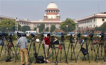 Tripods of television crew stand in front of the Supreme Court building in New Delhi December 7, 2010. REUTERS/B Mathur/Files