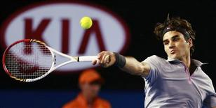 Roger Federer of Switzerland hits a return to Milos Raonic of Canada during their men's singles match at the Australian Open tennis tournament in Melbourne January 21, 2013. REUTERS/Tim Wimborne