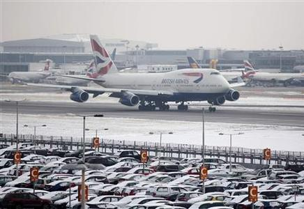 A British Airways aircraft takes off after snowfall at Heathrow airport in London January 21, 2013. London's Heathrow airport cancelled 10 percent of flights on Monday, a day after it cut its capacity by a fifth, and said services could face further delays with more snowfall expected. REUTERS/Neil Hall