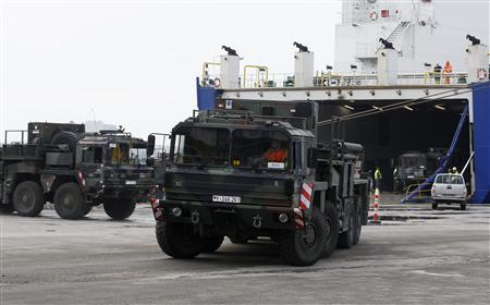 German military vehicles carrying equipment for NATO patriot defence missiles disembark at Turkey's Mediterranean port of Iskenderun in Hatay province January 21, 2013. REUTERS/Umit Bektas