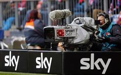 A SKY television camera operator is pictured during the German Bundesliga first division soccer match between Bayern and Greuther Fuerth in Munich January 19, 2013. REUTERS/Michael Dalder(GERMANY - Tags: SPORT SOCCER) DFL RULES TO LIMIT THE ONLINE USAGE DURING MATCH TIME TO 15 PICTURES PER GAME. IMAGE SEQUENCES TO SIMULATE VIDEO IS NOT ALLOWED AT ANY TIME. FOR FURTHER QUERIES PLEASE CONTACT DFL DIRECTLY AT + 49 69 650050