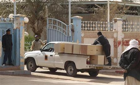 Algerian Sonatrach workers deliver empty coffins to collect body of hostages who were killed during a hostage crisis in a gas plant at the In Amenas hospital January 21, 2013. REUTERS/Ramzi Boudina
