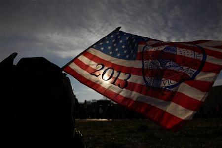 A souvenir flag is seen at the National Mall before the 57th inauguration ceremonies for U.S. President Barack Obama and Vice President Joe Biden on the West front of the U.S. Capitol, in Washington January 21, 2013. REUTERS/Eric Thayer (UNITED STATES - Tags: POLITICS SOCIETY)