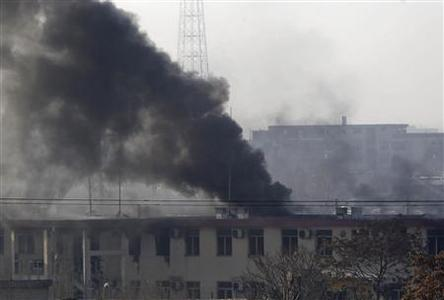 Smoke rises from the building of the Kabul traffic police headquarters during an insurgents' attack, in Kabul January 21, 2013. A coordinated attack involving at least three suicide bombers and a powerful car bomb took aim at the headquarters of the Kabul traffic department on Monday, followed by a clash between at least one insurgent and security forces, police said. REUTERS/Omar Sobhani