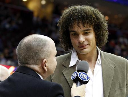 Cleveland Cavaliers Anderson Varejao talks with a TV reporter during the second quarter of the team's NBA basketball game against the Detroit Pistons in Cleveland February 9, 2011. REUTERS/Aaron Josefczyk