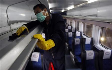 A worker uses disinfectant to clean the interior of a train in a Cairo trainyard, June 15, 2009. REUTERS/Amr Abdallah Dalsh