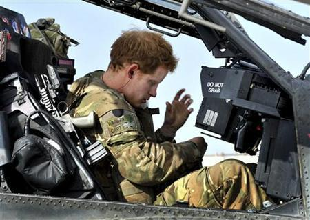 Britain's Prince Harry sits in the cockpit of an Apache helicopter in Camp Bastion, southern Afghanistan in this photograph taken October 31, 2012, and released January 21, 2013. REUTERS/John Stillwell/Pool