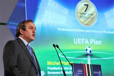 UEFA President Michel Platini speaks during the first session of the seventh Dubai International Sports Conference in Dubai, December 28, 2012. REUTERS/Mohammed Abu Omar