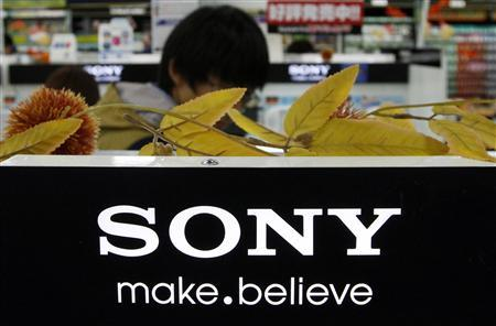 A man stands behind Sony Corp's logo at an electronics store in Tokyo October 31, 2012. REUTERS/Toru Hanai