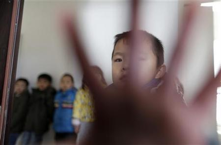 A child gestures in a classroom of a kindergarten in Wuhan, Hubei province, December 3, 2012. REUTERS/Stringer