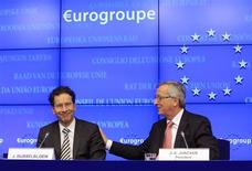 The Netherlands' Finance Minister Jeroen Dijsselbloem (L) is congratulated by Luxembourg's Prime Minister and former Eurogroup Chairman Jean-Claude Juncker during his first news conference after being appointed new Eurogroup President during a euro zone finance ministers meeting in Brussels January 21, 2013. REUTERS/Yves Herman