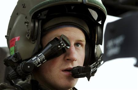 Britain's Prince Harry wears his monocle gun sight as he sits in his Apache helicopter in Camp Bastion, southern Afghanistan in this photograph taken December 12, 2012, and released January 21, 2013. The Prince, who is serving as a pilot/gunner with 662 Squadron Army Air Corps, is on a posting to Afghanistan that runs from September 2012 to January 2013. Photograph taken December 12, 2012. REUTERS/John Stillwell/Pool