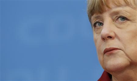 German Chancellor Angela Merkel is pictured during a news conference at the headquarters of Merkel's Christian Democratic Union party CDU in Berlin January 21, 2013. Months before German general elections, Merkel received a bitter defeat in an extremely tight German state election by losing power to the centre-left Social Democrats (SPD) and Greens, who together garnered just one more seat in the Lower Saxony state assembly than the centre-right. REUTERS/Wolfgang Rattay
