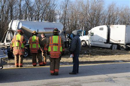 Ohio authorities respond to multi-car crash on Interstate 275 between Hamilton and Colerain avenue exits in Colerain Township, northwestern Hamilton County, near Cincinnati, Ohio January 21, 2013. REUTERS/Joe Wessels