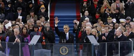 President Barack Obama waves to the crowd after delivering his inaugural address during the presidential inauguration on the West Front of the U.S. Capitol in Washington January 21, 2013. REUTERS/Scott Andrews/Pool