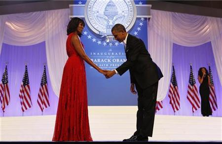 U.S. President Barack Obama bows to First Lady Michelle Obama at the Inaugural ball in Washington, January 21, 2013. REUTERS/Kevin Lamarque