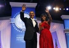 U.S. President Barack Obama and first lady Michelle Obama wave to attendees at the Inaugural Ball in Washington, January 21, 2013. REUTERS/Kevin Lamarque
