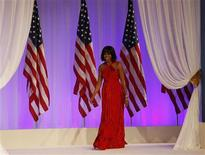 First lady Michelle Obama takes the stage at the Commander in Chief's Ball in Washington, January 21, 2013. Michelle Obama's dress was designed by Jason Wu. REUTERS/Rick Wilking