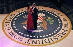 U.S. first lady Michelle Obama, wearing a Jason Wu dress, dances with U.S. President Barack Obama at the Commander in Chief's ball in Washington, January 21, 2013. REUTERS/Pablo Martinez Monsivais/POOL
