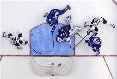 Toronto Maple Leafs goalie Ben Scrivens (30) makes a save on Buffalo Sabres' Cody Hodgson (19) during the third period of their NHL hockey game in Toronto January 21, 2013. REUTERS/Mark Blinch