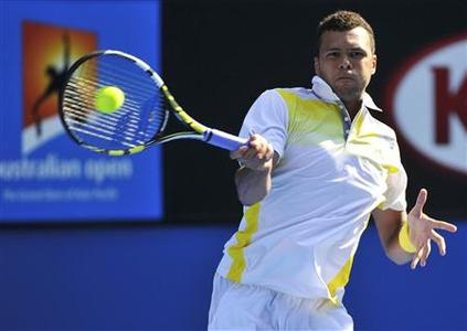 Jo-Wilfried Tsonga of France hits a return to compatriot Richard Gasquet during their men's singles match at the Australian Open tennis tournament in Melbourne January 21, 2013. REUTERS/Toby Melville