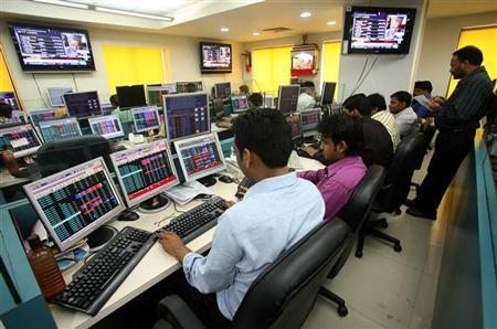 Stock brokers trade in a brokerage firm in Kolkata February 16, 2009. REUTERS/Jayanta Shaw/Files