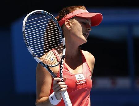 Agnieszka Radwanska of Poland reacts during her women's singles quarter-final match against Li Na of China at the Australian Open tennis tournament in Melbourne January 22, 2013. REUTERS/Damir Sagolj