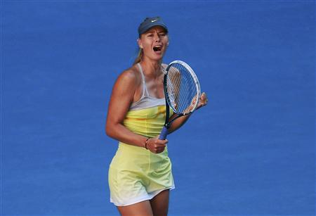 Maria Sharapova of Russia celebrates defeating compatriot Ekaterina Makarova in their women's singles quarter-final match at the Australian Open tennis tournament in Melbourne January 22, 2013. REUTERS/Tim Wimborne