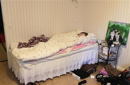Emelie Olsson sleeps during daytime in Stockholm January 20, 2013. REUTERS/Ints Kalnins