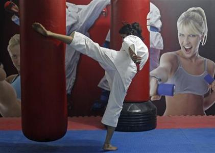 Sweety, 22, a student, takes a self defence class in New Delhi, January 14, 2013. Sweety travels four hours every day from her village to the city to learn karate and taekwondo. She said, ''boys in my village are scared to tease me after I beat up one boy who was passing lewd comments on me''. Since a medical student died after being gang raped on a bus in New Delhi, the issue of women's security in India has been under the spotlight. Picture taken January 14, 2013. REUTERS/Mansi Thapliyal
