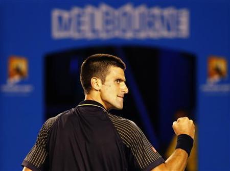Novak Djokovic of Serbia celebrates winning the second set during his men's singles match against Stanislas Wawrinka of Switzerland at the Australian Open tennis tournament in Melbourne January 20, 2013. REUTERS/Daniel Munoz