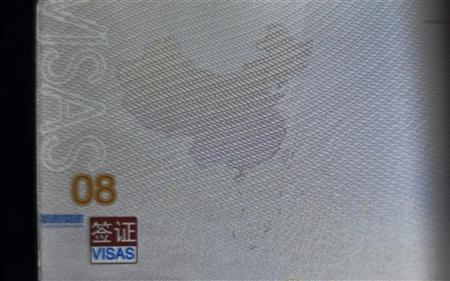 A page from a Chinese passport displays a Chinese map which includes an area in the South China Sea inside a line of dashes representing maritime territory claimed by China, in Kunming, Yunnan province, November 23, 2012. REUTERS/Stringer