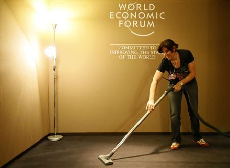 A woman cleans inside the Congress Hall of the World Economic Forum (WEF) at the Swiss Alpine resort of Davos January 21, 2013. REUTERS/Pascal Lauener