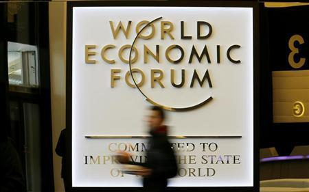 A man walks past the official logo of the World Economic Forum (WEF) inside the Congress Hall at the Swiss Alpine resort of Davos January 22, 2013. REUTERS/Pascal Lauener