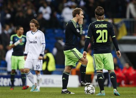 Ajax Amsterdam's Christian Eriksen (L) and Lasse Schone after Real Madrid's fourth goal during their Champions League Group D soccer match at the Santiago Bernabeu stadium in Madrid December 4, 2012. REUTERS/Susana Vera
