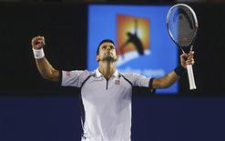 Novak Djokovic of Serbia celebrates defeating Tomas Berdych of Czech Republic in their men's singles quarter-final match at the Australian Open tennis tournament in Melbourne January 22, 2013. REUTERS/Scott Barbour/Pool