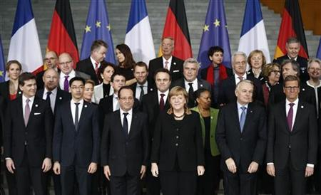 German Chancellor Angela Merkel and French President Francois Hollande (first row 3rd L) pose with French and German ministers and officials at the Chancellery in Berlin January 22, 2013, during a day of celebrations marking the 50th Anniversary of the Elysee Treaty. REUTERS/Thomas Peter (GERMANY - Tags: POLITICS ANNIVERSARY)