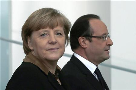 German Chancellor Angela Merkel (L) and French President Francois Hollande leave a family picture opportunity at the chancellery in Berlin during a day of celebrations marking the 50th Anniversary of the Elysee Treaty, January 22, 2013. REUTERS/Thomas Peter