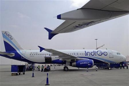 An IndiGo Airlines A320 aircraft is parked on the tarmac at Bengaluru International Airport in Bangalore March 7, 2012. REUTERS/Vivek Prakash/Files