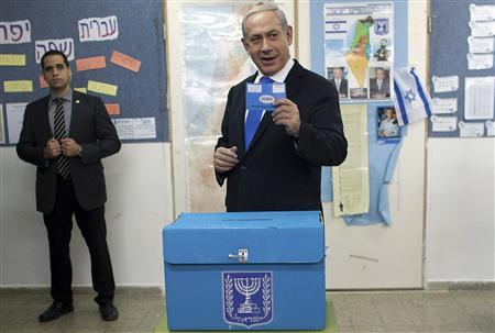 Israel's Prime Minister Benjamin Netanyahu casts his ballot for the parliamentary election at a polling station in Jerusalem January 22, 2013. REUTERS/Uriel Sinai/Pool
